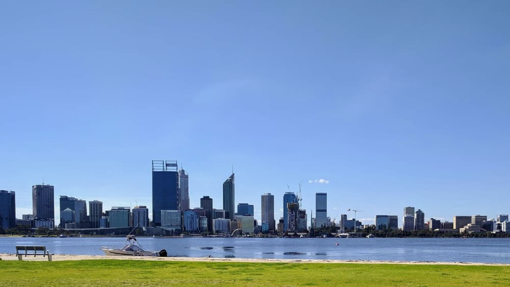 South Perth picnic spot. Grassy area looking out to the swan river and Perth City