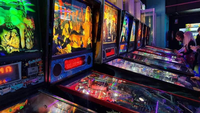 Planet Royale pinball machines in the Barcadia venue. Image shows 8 of the pinball machines in a row